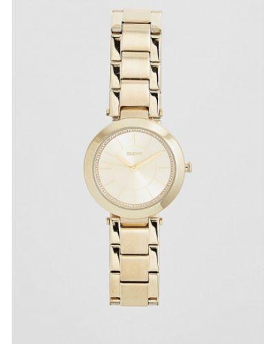 Кварцевые часы золотого цвета Dkny