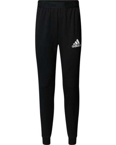 Spodnie dresowe bawełniane z printem Adidas Performance