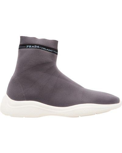 Высокие кроссовки в полоску с логотипом Prada