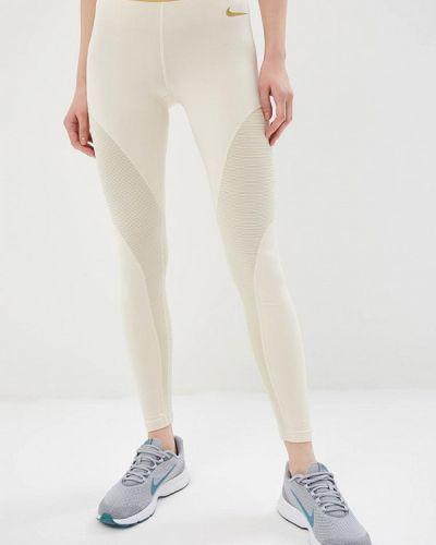 Бежевые леггинсы Nike