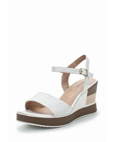 Белые босоножки на каблуке Covani