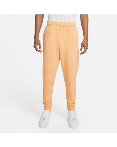 Joggery dzianinowe - pomarańczowe Nike