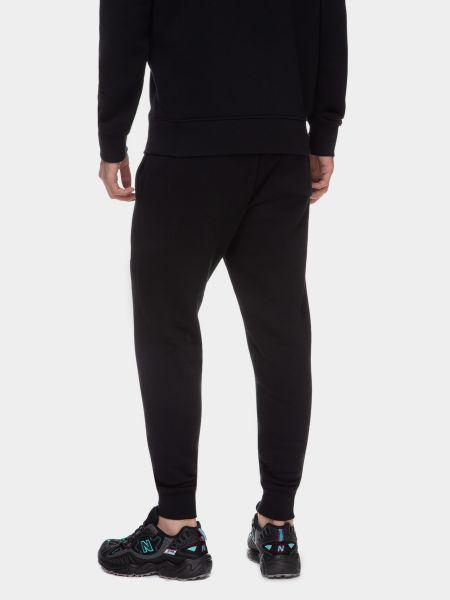 Черные спортивные брюки New Balance