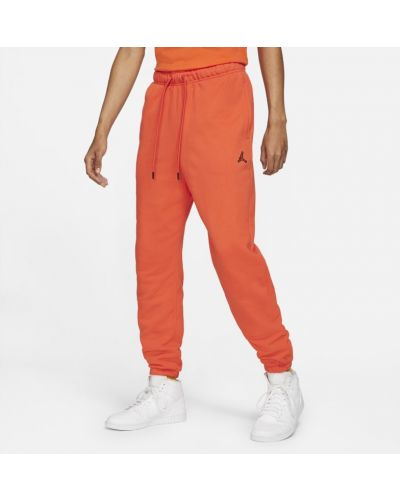 Pomarańczowe spodnie casual Jordan