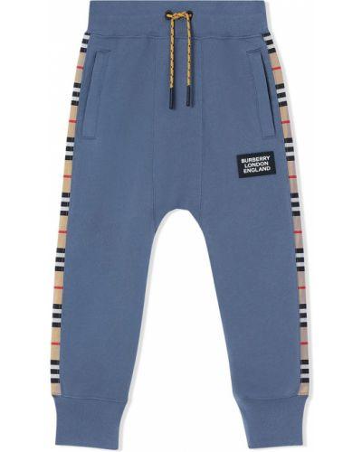 Хлопковые серые спортивные брюки в клетку Burberry Kids