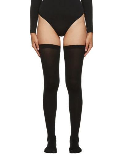 Бесшовные черные нейлоновые носки высокие с манжетами Wolford