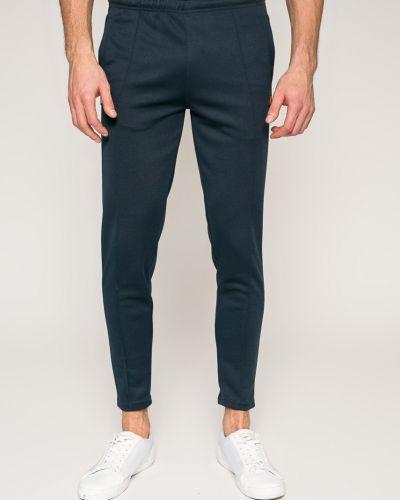 Зауженные брюки Ellesse
