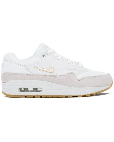 Белые кожаные кроссовки Nike