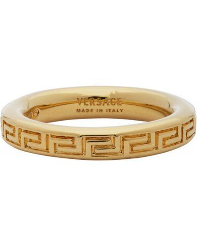 Тонкое кольцо металлическое золотое Versace