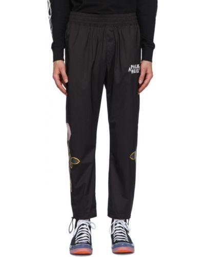 Nylon czarny spodnie z kieszeniami z mankietami Palm Angels