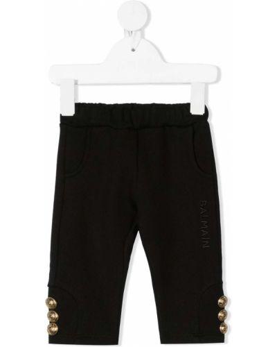 Złote czarne legginsy Balmain Kids