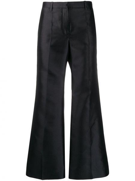 Przycięte spodnie z kieszeniami rozkloszowane Givenchy