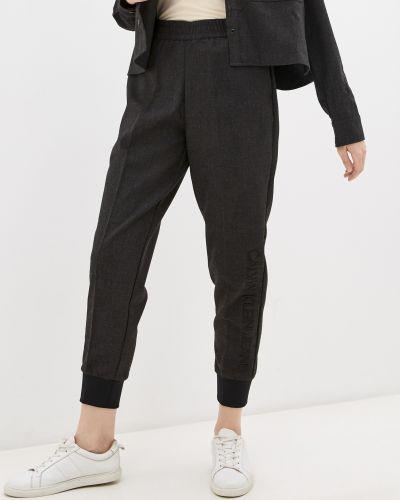 Флисовые джоггеры - серые Calvin Klein Jeans
