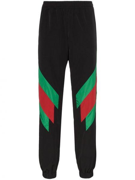 Czarne spodnie w paski Gucci