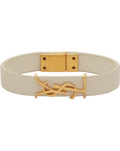 Кожаный золотой браслет золотой с тиснением Saint Laurent