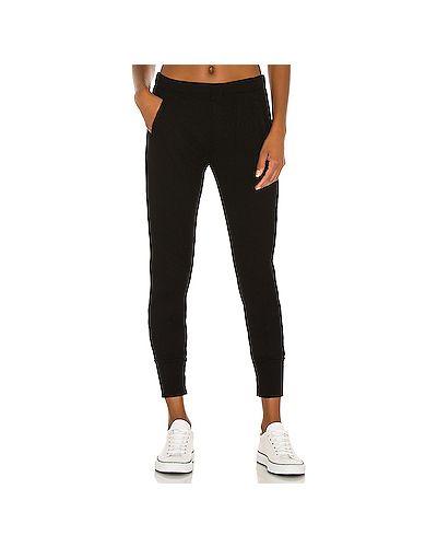 Черные брюки на резинке с карманами с манжетами в рубчик Enza Costa