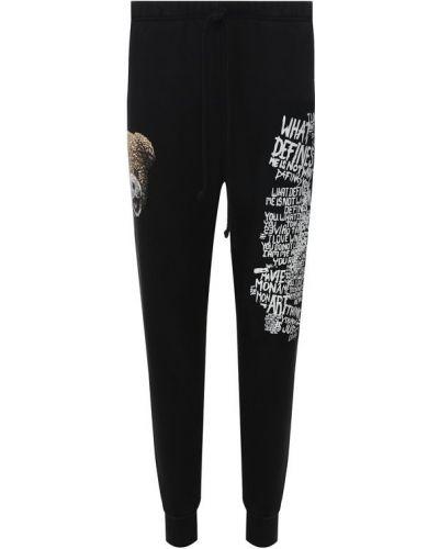 Спортивные брюки черные с надписью Dom Rebel