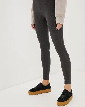 Серые брюки Calzedonia