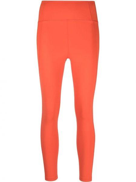 Pomarańczowe legginsy materiałowe Girlfriend Collective