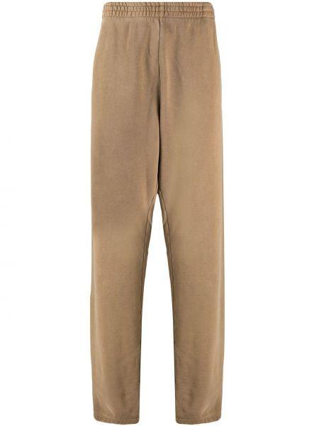 Beżowe spodnie bawełniane do pracy Yeezy