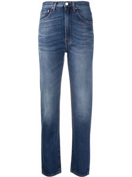 Z wysokim stanem bawełna niebieski jeansy na wysokości z kieszeniami Toteme