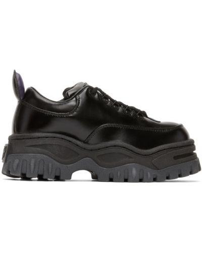 Кожаные черные кроссовки на платформе Eytys