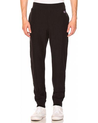 Spodnie bawełniane - czarne Champion Reverse Weave