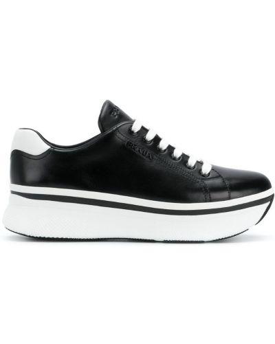 Кроссовки на платформе кожаные на шнуровке Prada