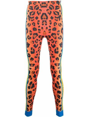 Pomarańczowe legginsy z printem Walter Van Beirendonck