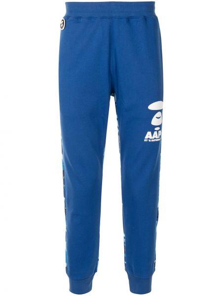 Хлопковые синие брюки с карманами Aape By A Bathing Ape