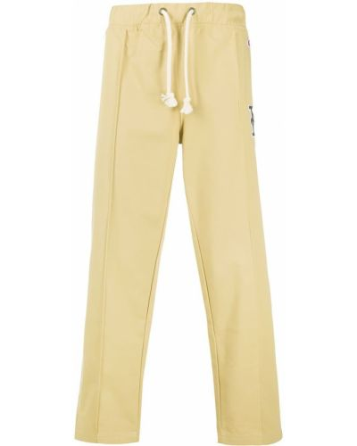 Хлопковые бежевые спортивные брюки с нашивками с карманами Champion