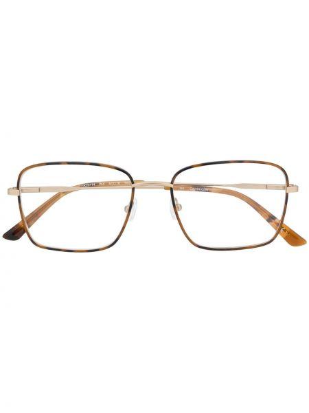 Brązowy oprawka do okularów metal przeoczenie Calvin Klein
