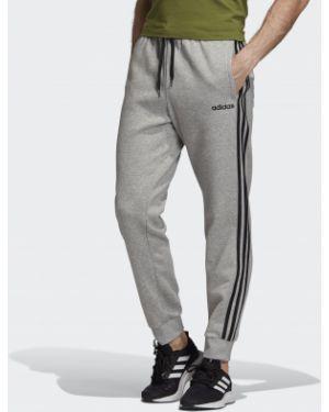 Спортивные брюки черные с манжетами Adidas