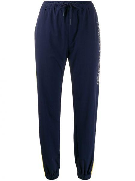 Spodnie na gumce sportowe z kieszeniami Tommy Jeans