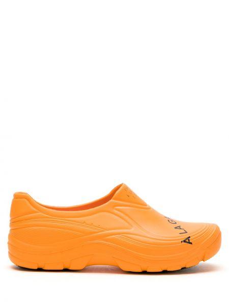Оранжевые ботинки à La Garçonne