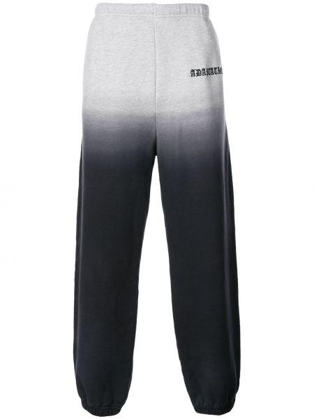 Czarne spodnie bawełniane z haftem Adaptation