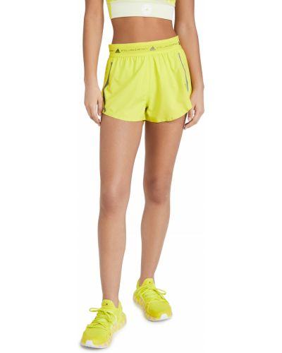 Желтые короткие шорты в полоску с карманами Adidas By Stella Mccartney