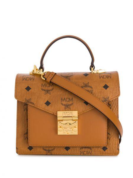 Кожаная сумка - золотая Mcm