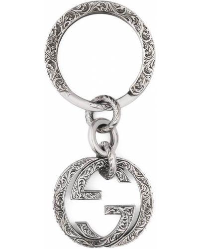 Серебряный брелок с декоративной отделкой Gucci