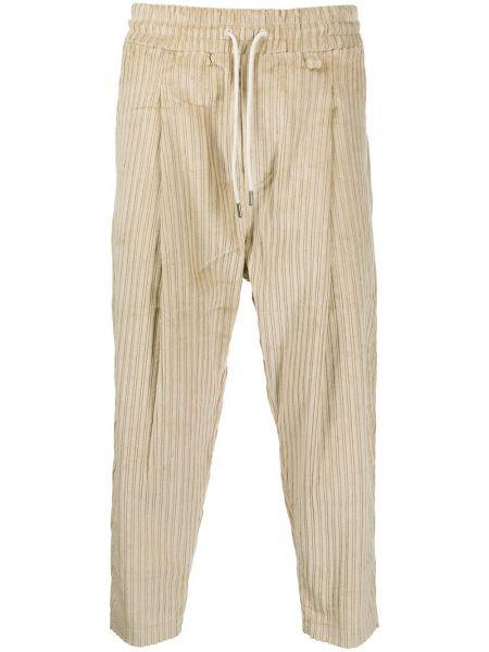 Prążkowane beżowe spodnie bawełniane Drole De Monsieur