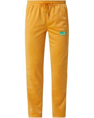 Żółte spodnie w paski z paskiem Sergio Tacchini