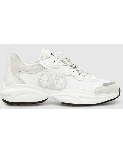 Белые кроссовки Valentino