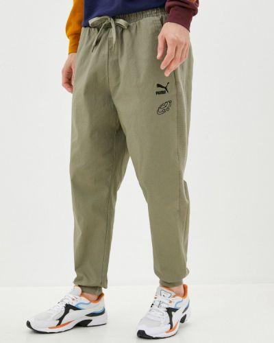 Зеленые спортивные брюки Puma