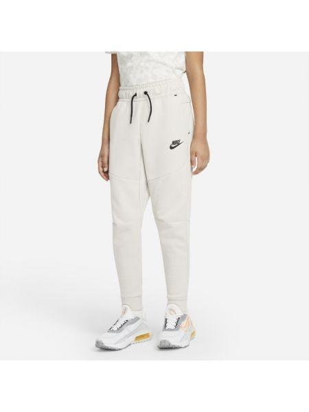 Ciepłe szare spodnie dzianinowe Nike