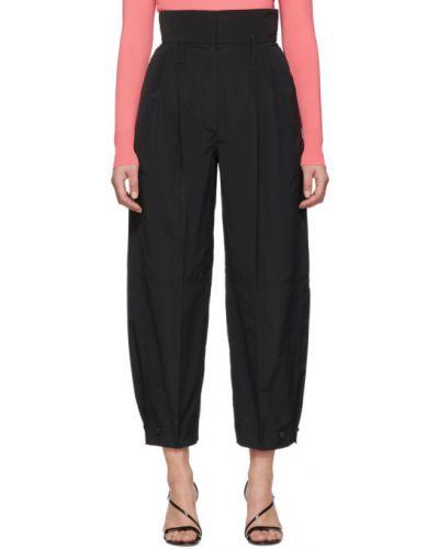 Spodni czarny spodnie z kieszeniami z mankietami Givenchy