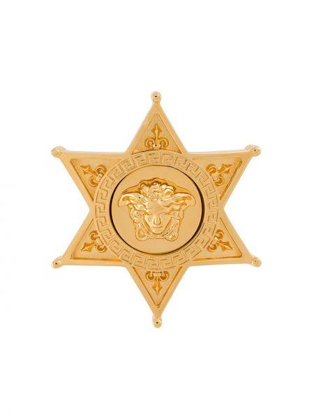 Złota broszka Versace