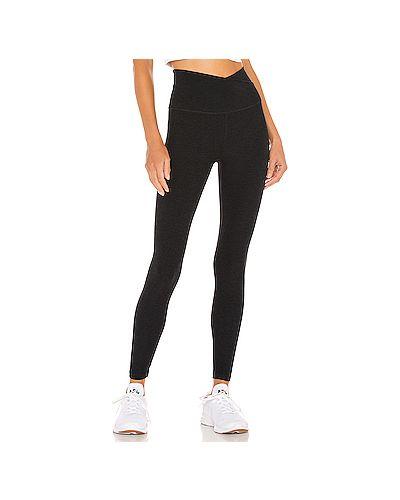 Черные брюки для йоги эластичные Beyond Yoga