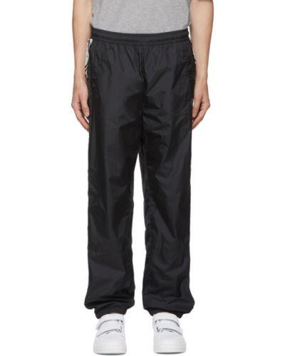 Czarny spodnie sportowe z paskami z mankietami prążkowany Acne Studios
