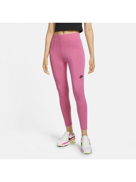 Różowy legginsy Nike