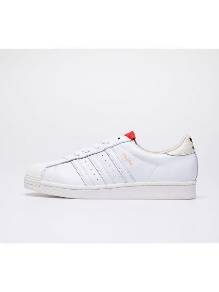 Czerwone półbuty Adidas Consortium